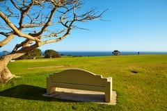 Bench on a hill near the ocean. In Malibu California Stock Photos