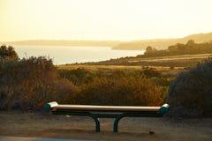 Bench on a hill near the ocean. In Malibu California Stock Photo