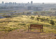 Bench on a hilltop overlooking the city in the Negev desert. Bench on a hilltop overlooking the Be`er Sheva city in the Negev desert, Israel Stock Photo