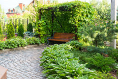 Bench in home garden Stock Photos