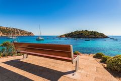 Boats at beautiful seaside landscape on Majorca. Bench with idyllic sea view of the coast in Sant Elm with yachts boats, Mallorca island, Spain Mediterranean Sea Royalty Free Stock Image