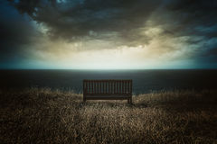 Bench In Front Of A Dramatic Cloudscape Stock Images