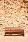 Bench infront of an old wall Royalty Free Stock Images