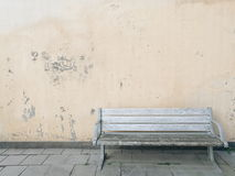 Bench isolated on old wall Stock Images