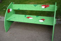 Bench with ladybirds Stock Photo
