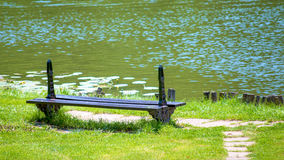 Bench and lake Royalty Free Stock Images