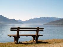 Bench at lake stock image