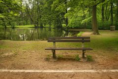 Bench by a lake Stock Images
