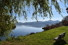 Bench by the lake of Kastoria Greece. Royalty Free Stock Photography