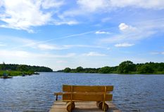 Bench by the lake Stock Images