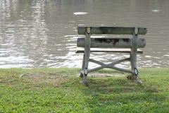 Bench beside lake. Stock Photography