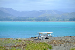 Bench beside lake Pukaki with mount cook. Background royalty free stock images