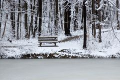 Bench at lake's edge Stock Photos