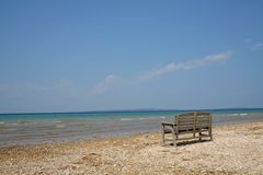 A bench on lake shore Stock Image