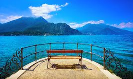 Bench on lakefront in Como Lake landscape. Bellagio Italy Royalty Free Stock Image