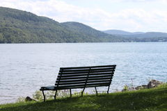 Bench on lakeside Royalty Free Stock Photo