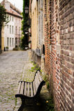 Bench in a lane in Ghent. Tipical lane in Ghent, Belgium with cobbels and a bench stock photos