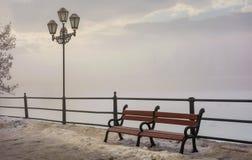 Bench and lantern on foggy winter morning. Location Nezalezhnosti embankment Uzhgorod, Ukraine royalty free stock photography