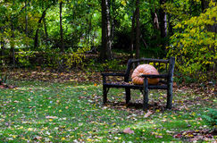 Bench with large pumpkin Royalty Free Stock Photography
