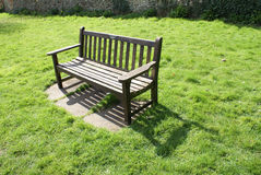 Bench on the lawn Stock Photography