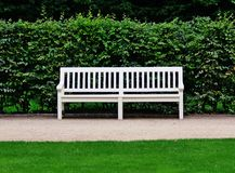Bench in Lazienki. White bench in Royal Lazienki Gardens in Warsaw royalty free stock images