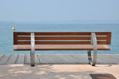 Bench at the lead shore Royalty Free Stock Photo