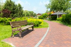 Bench in the local park Royalty Free Stock Image