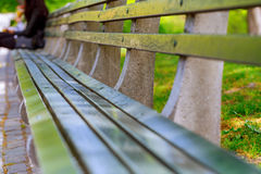 Bench in the local park stock photo