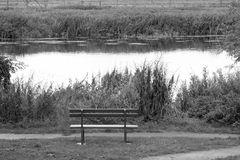 Bench. Looking over a river waiting for someone to have a rest Stock Image