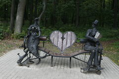 Bench for lovers. Bench in the park for lovers stock photography