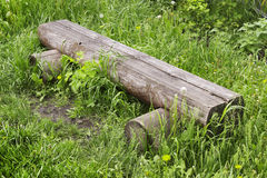 Bench made in log in village street Royalty Free Stock Photos