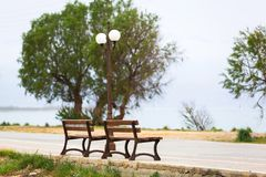 Bench at Maleme bech on Crete. Greece Royalty Free Stock Photography