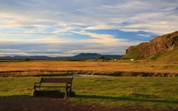 Iceland landscape. Bench in a meadow in Iceland Royalty Free Stock Photos