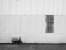 Bench and metal sheet wall Royalty Free Stock Photography