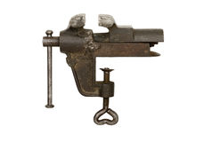 Bench Metal Vise. A old bench metal vise grip over white background Royalty Free Stock Images
