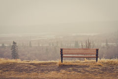 Bench in the Mist. Bench looking over a misty landscape Royalty Free Stock Images