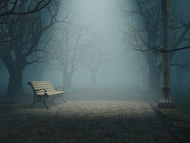 Bench in misty park Royalty Free Stock Image