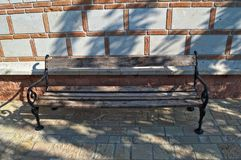 Bench in Monastery on late summer sun Royalty Free Stock Photo