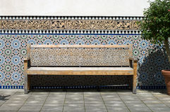 Bench in the Moroccan courtyard. Royalty Free Stock Photography