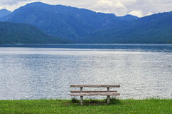 Bench at mountain lake Royalty Free Stock Image
