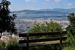Bench on the mountain overlooking the big city stock photo