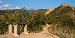 Bench on a Mountain Path. Bench on the path to Stob Pyramid rock formation in Bulgaria Royalty Free Stock Image