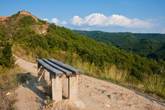 Bench on a Mountain Path. Bench on the path to Stob Pyramid rock formation in Bulgaria Stock Images