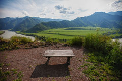 Bench Mountain View. Bench on the observation deck with views of the mountains and the river Stock Images