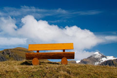 Bench on the mountain way Stock Images