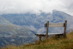 Bench in mountain Stock Images
