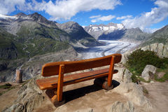 A bench in the mountains above the Aletsch glacier Stock Image