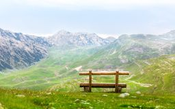 Bench in mountains Stock Photography
