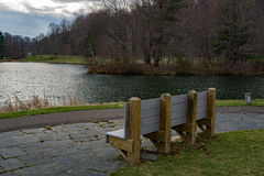 A Bench by a Mountian Lake Stock Image