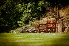 Bench in nature park Stock Photos